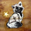 Macskás díszítés rönk játszótéren